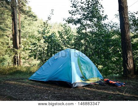 tent in the green woods no peoples