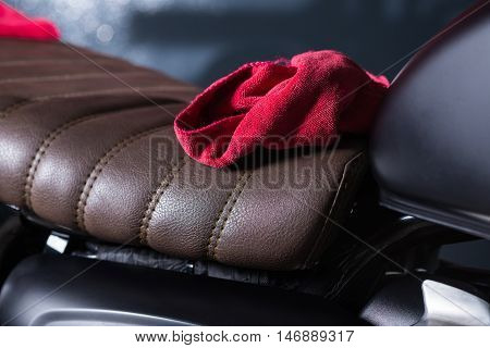 Motorcycles detailing series : Red cloth on vintage motorcycle seat