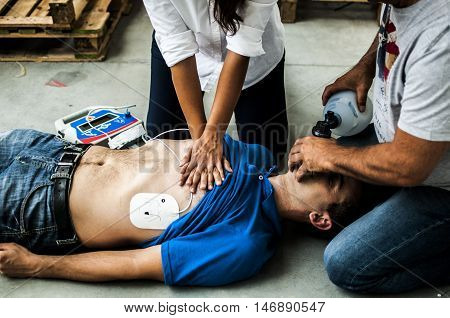 people making CPR to an unconscious man