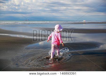 Cute Little Girl Walking On New Plymouth Beach, Nz