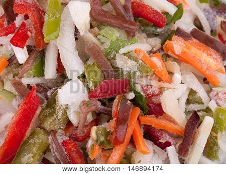 Frozen Chinese mix vegetables with black fungus mushrooms strips close up. Diet food for healthy life.