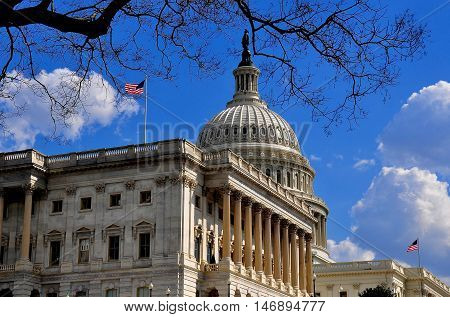 Washington DC - April 9 2014: Senate wing (left) great dome and west front of of the United States Capitol *