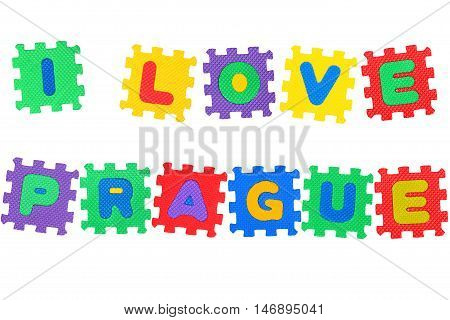 Message I Love Prague from letters puzzle isolated on white background.