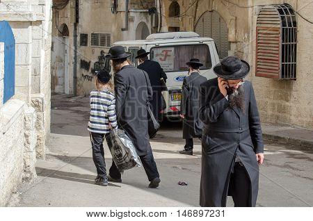 JERUSALEM ISRAEL - MARCH 30 2012: Orthodox Jewish people walks in jewish quarter. Jerusalem. Israel