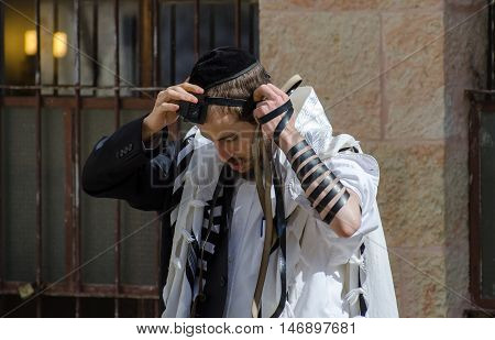 JERUSALEM ISRAEL - MARCH 30 2012: Orthodox Jewish man pray in jewish quarter. Jerusalem. Israel