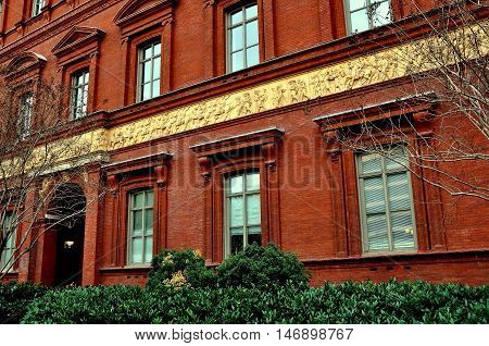 Washington DC -April 11 2014: A three foot high 19th century Civil War frieze by sculptor Casper Buberl adorns the former Pension Building now the National Building Museum