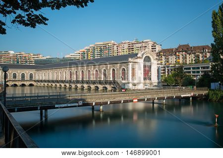 Long exposure view of the Batiment des Forces Motrices on the Rhone river Geneva - Switzerland.