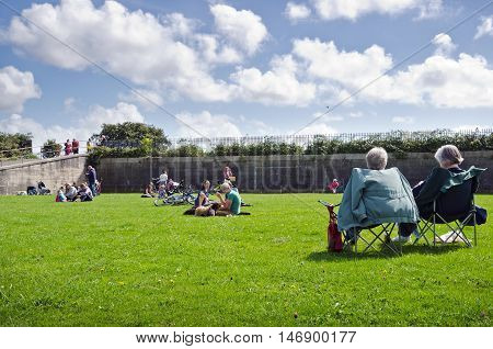 PLYMOUTH, ENGLAND. 11th September 2016. Local residents flocked to attend a protest picnic held in the grade II listed reservoir at Devil's Point Park, which is at risk of being turned into a car park by developers.