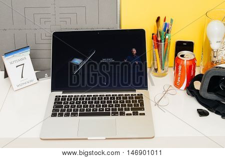 PARIS FRANCE - SEP 8 2016: Apple Computers website on MacBook Retina in room environment showcasing live coverage of Apple Keynote - performance of the new A10 Fusion chip gpu cpu performance