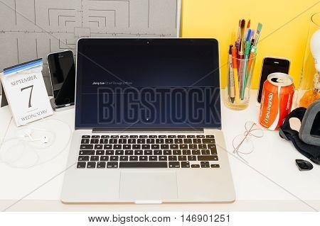 PARIS FRANCE - SEP 8 2016: Apple Computers website on MacBook Retina in room environment showcasing live coverage of Apple Keynote - Jony Ive iPhone 7 fil