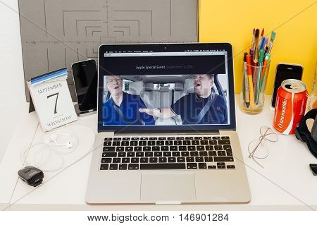 PARIS FRANCE - SEP 8 2016: Apple Computers website on MacBook Retina in room environment showcasing live coverage of Apple Keynote - CEO Tim Cook singing with James Corden in a Carpool Karaoke type video