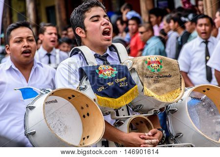 Antigua Guatemala - September 15 2015: Bands march in street parade during Guatemalan Independence Day celebrations