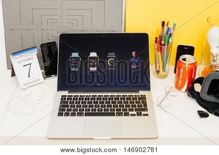 PARIS FRANCE - SEP 8 2016: Apple Computers website on MacBook Retina in room environment showcasing live coverage of Apple Keynote - Apple COO Jeff Williams about new Apple Watch Series 2