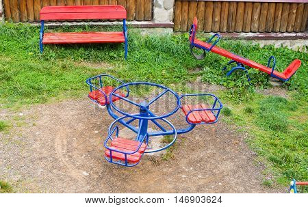 playground with swings  round, colors, blue metal