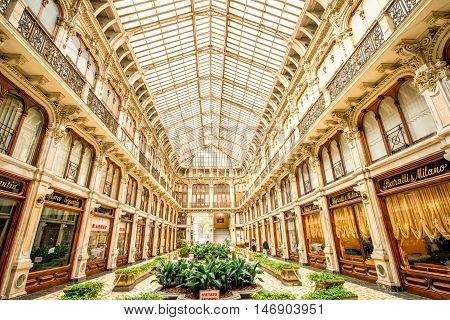 Turin, Italy - June 10, 2016: Historical shopping Galleria San Federico constructed in 1932 by Federico Canova and Eugenio Corte in Turin, Italy