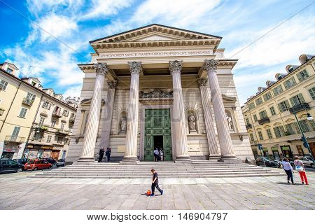 Turin, Italy - June 12, 2016: Chiesa Massimo church with people walk in Turin city in Piedmont region in Italy