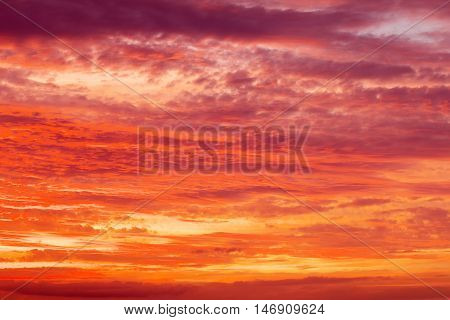 Beautiful fiery orange and red apocalyptic sunset sky.
