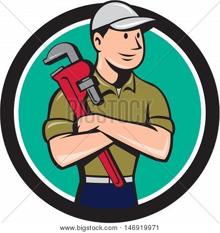 Illustration of a plumber wearing hat looking to the side arms crossed holding monkey wrench viewed from front set inside circle on isolated background done in cartoon style.
