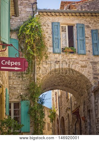Typical French street with Crepes sign in Vezenobres