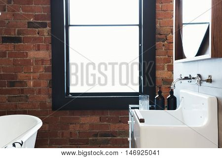 Vintage warehouse bathroom conversion with large blank window for space for text