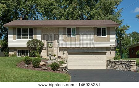 White, Split-level House With Lower Garage