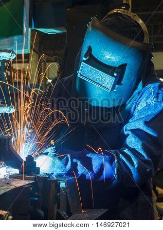 welder welding Industrial automotive part in factory