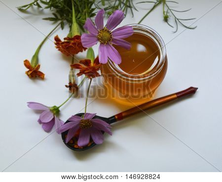 Bank of fragrant honey with flowers , healthy food