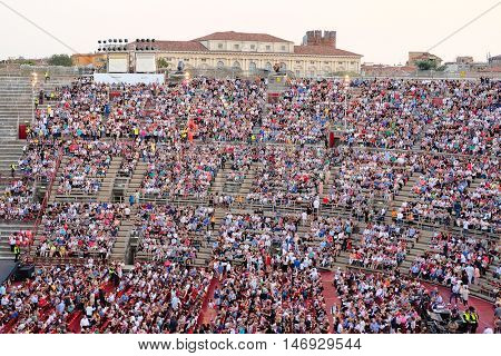 VERONA, ITALY - JULY, 4, 2016: onlookers on a concert in Arena of Verona (in italian - Arena di Verona) - ancient amphitheater, today used as a theatre stage