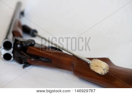 Gun cleaning kit on a white background.