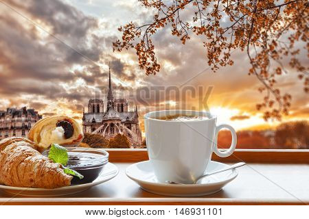 Breakfast Coffee and Croissant with beautiful sunrise