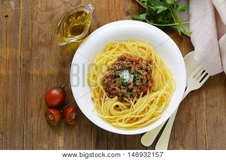 traditional pasta with Bolognese sauce with parmesan and herbs