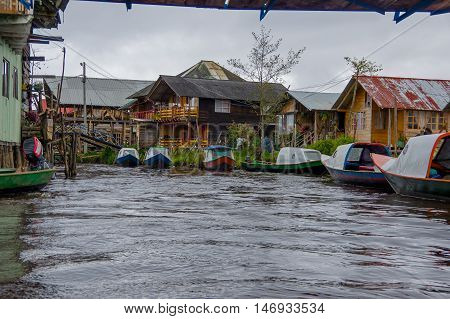 PASTO, COLOMBIA - JULY 3, 2016: some small houses located on the shore of la cocha lake.