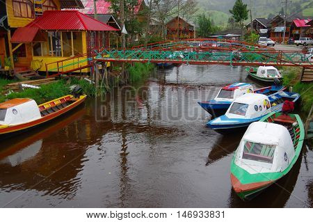 PASTO, COLOMBIA - JULY 3, 2016: small colorfull boats parked in a shore of la cocha lake in the south of colombia