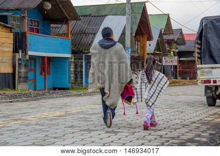 PASTO, COLOMBIA - JULY 3, 2016: native people with traditional clothes walking in the street in la cocha lake.