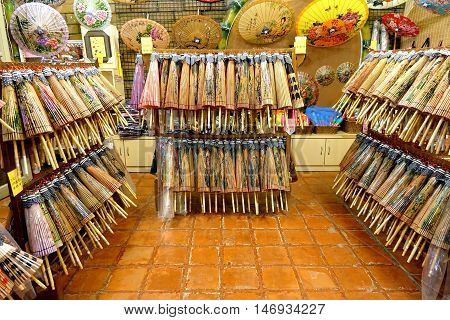 Chinese Hand-made Oil-paper Umbrellas Are Sold In A Store