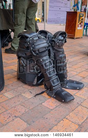 PASTO, COLOMBIA - JULY 3, 2016: police equipment standing on the floor next to a stand in the central square of the city.
