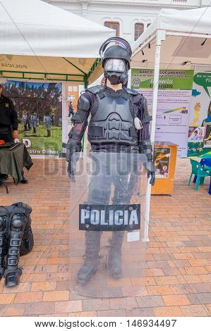 PASTO, COLOMBIA - JULY 3, 2016: manikin dressed with some police equipment in nthe center square of the city.