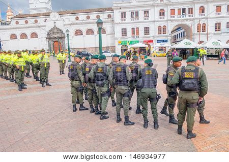 PASTO, COLOMBIA - JULY 3, 2016: police squad standing on the ventral square wearing lifejackets.