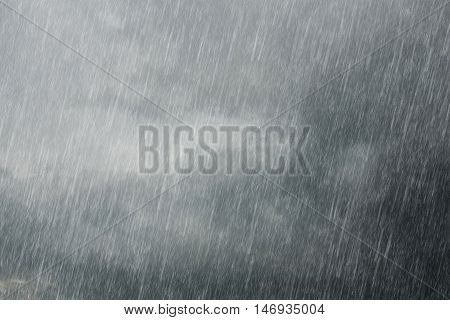 the dark storm clouds with falling rain