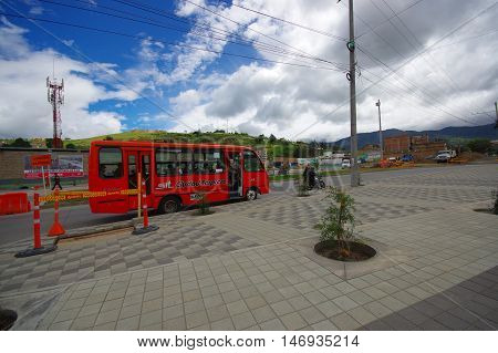 PASTO, COLOMBIA - JULY 3, 2016: public bus with some passenger inside driving trough the city.