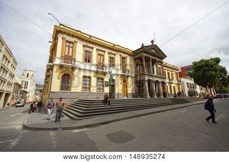 PASTO, COLOMBIA - JULY 3, 2016: outside view of the government building, some pedestrians walking on the street in front of the building.