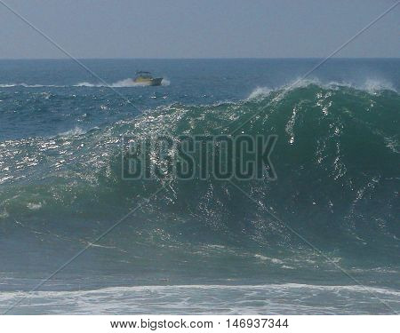 An unidentified boater surveys the big waves of The Wedge in Newport Beach, CA (September 2011)