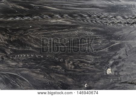 Blury, Movement, Ripples in shallow water over a Black sand Beach, Langkawi, Malaysia