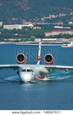 Gelendzhik Russia - September 8 2010: Beriev Be-200 amphibian plane is getting out of the water to land on the ramp
