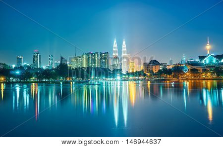 Night view of Kuala Lumpur city with stunning reflection in water