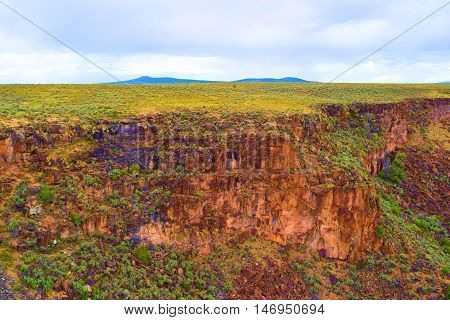 Elevated landscape called a plateau with grasslands taken on the mesa in Northern New Mexico