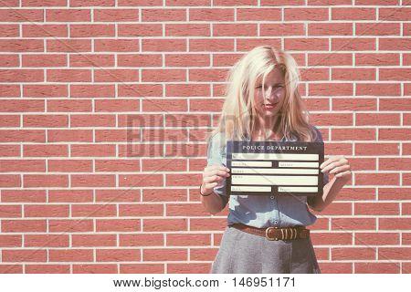 Mugshot of cute blonde woman