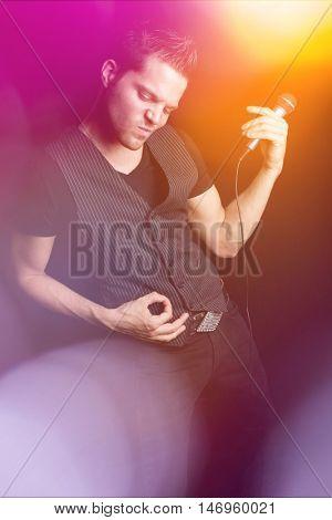 Music man playing air guitar