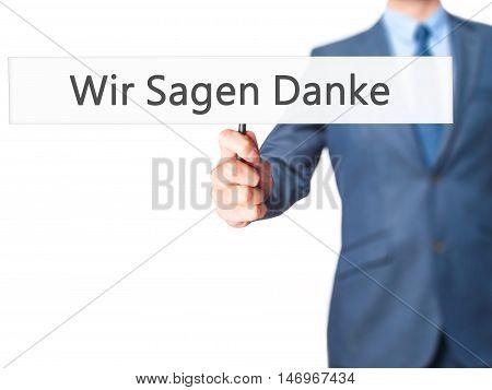 Wir Sagen Danke (we Say Thank You In German) - Businessman Hand Holding Sign