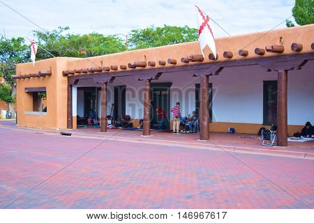 Santa Fe, NM - September 12, 201:  Historic adobe style Palace of the Governor's Building built in 1610 which has been a seat of government for New Mexico during centuries and where Native Americans sell and trade their merchandise at the courtyard.
